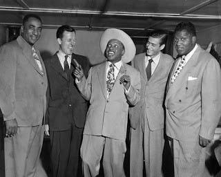 "From left: Charles Sullivan, known as ""the mayor of the Fillmore""; Ralph J Gleason, jazz and rock critic for the San Francisco Chronicle; Lionel Hampton wearing Wesley Johnson's 10-gallon Stetson hat; two unknown men at Wesley Johnson's Texas Playhouse. Photo: Wesley Johnson Jr Collection"