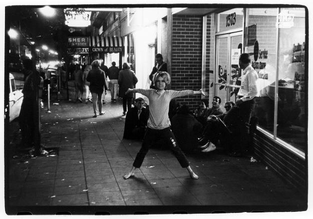 Sidewalk at night, a girl poses. By William Gedney, 1966. Courtesy of Duke University Library.