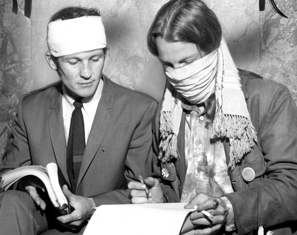 Hallinan with Ron Thelin before his trial for reading poetry while masked, May 23, 1968. / Photo by Duke Downey, Courtesy of The San Francisco Chronicle