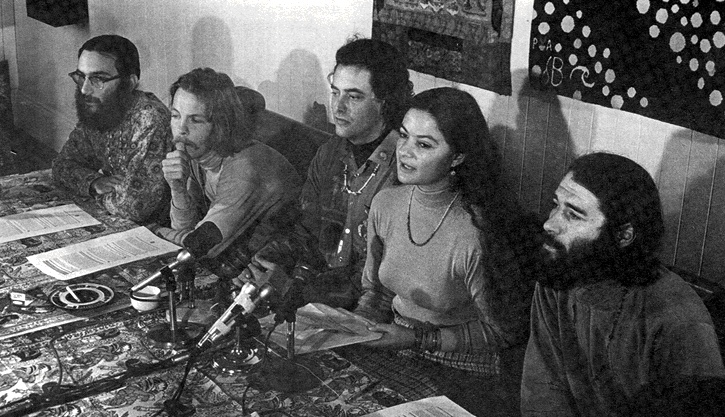 Allen Cohen and Ron Thelin to the far left as Lenore Kandel addresses a press conference, 1967. / Courtesy of the San Francisco Chronicle via FoundSF
